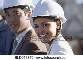 多少数民族成员, businesspeople, 穿, hardhats bld051870 搜索照