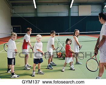 Picture - male tennis instructor 