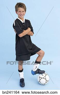 Stock Photo - boy in soccer  uniform with soccer  ball. fotosearch  - search stock  photos, pictures,  images, and photo  clipart