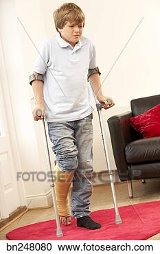 Stock Photography - boy using forearm crutches  fotosearch - search    Using Forearm Crutches