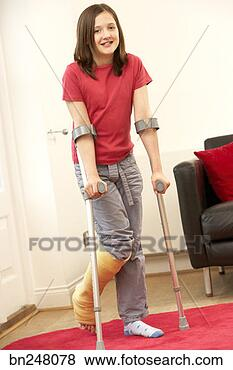 Stock Photo - girl using forearm crutches  fotosearch - search stock    Using Forearm Crutches
