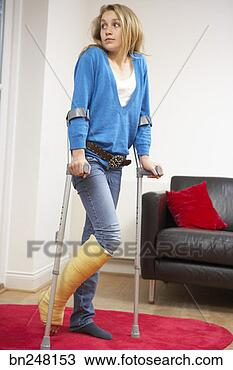 Stock Photo - teen girl using forearm crutches  fotosearch - search    Using Forearm Crutches
