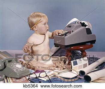 Stock photo of baby child office rotary telephone adding for Telephone mural 1970