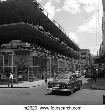 stock photography of 1950s new type parking lot three story bulding architecture car on street. Black Bedroom Furniture Sets. Home Design Ideas