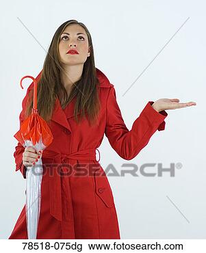 Stock Photo - woman in red trench 