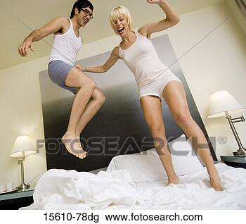 http://comps.fotosearch.com/comp/CRT/CRT543/couple-jumping-bed_~15610-78dg.jpg