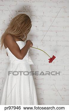 Banco de Imagem - mulher,  segurando,   flor. fotosearch  - busca de fotos,  imagens e clipart