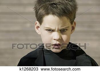 Stock Photo - close up of a  boy with at. fotosearch  - search stock  photos, pictures,  images, and photo  clipart
