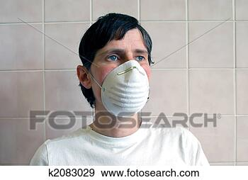 Stock Photograph - person with surgical  mask. fotosearch  - search stock  photos, pictures,  images, and photo  clipart