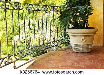 Stock Photo - Plant on tiled Mexican veranda. Fotosearch - Search Stock Images, Mural Photographs, Pictures, and Clipart Photos
