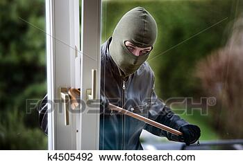 Stock Photo - burglar at a window.  fotosearch - search  stock photos,  pictures, wall  murals, images,  and photo clipart