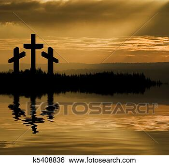 Stock Image - Silhouette of Jesus Christ crucifixion on cross on Good Friday Easter reflected in lake water. Fotosearch - Search Stock Photography, Poster Photos, Pictures, and Photo Clip Art