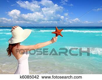 Banco de Imagem - praia, chapéu,  mulher, starfish,  mão, tropicais,  caraíbas. fotosearch  - busca de fotos,  imagens e clipart