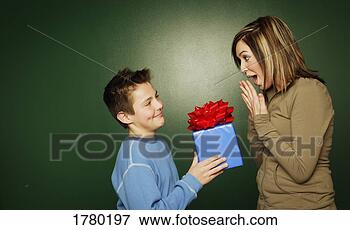 Gift Girl Gift on Picture Of Boy Gives A Gift To Girl 1780197   Search Stock Photography