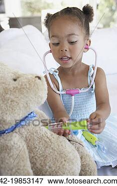 Picture - girl playing doctor.  fotosearch - search  stock photos,  pictures, wall  murals, images,  and photo clipart
