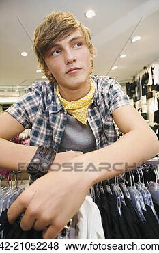 Stock Photo - teen boy in clothing store. fotosearch - search stock