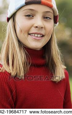 Picture - Preteen girl wearing a sweater and stocking cap. Fotosearch ...