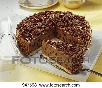Stock Photo - hazelnut chocolate cheesecake with grated chocolate, a piece cut. fotosearch - search stock photos, pictures, images, and photo clipart