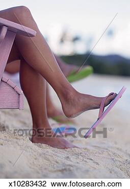 Stock Photo of Woman Wearing Thongs at the Beach