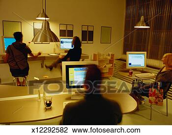 Stock Photo - people using computers  in an internet  café. fotosearch  - search stock  photos, pictures,  wall murals, images,  and photo clipart