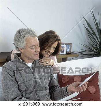 Mature Couple Looking At S Woman Over Man