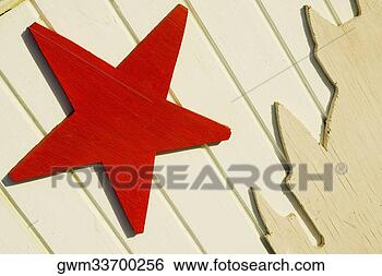 Stock Photo - close-up of a  star shape on  a wooden surface.  fotosearch - search  stock photos,  pictures, wall  murals, images,  and photo clipart
