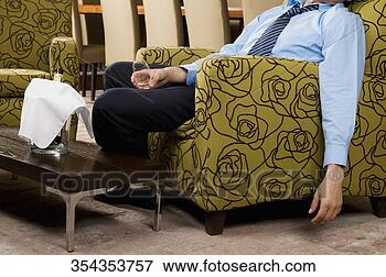 Picture - drunk businessman  sitting in an  armchair. fotosearch  - search stock  photos, pictures,  wall murals, images,  and photo clipart