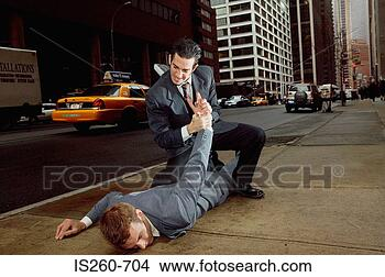 Stock Photo - businessmen fighting in street. fotosearch - search stock photos, pictures, wall murals, images, and photo clipart