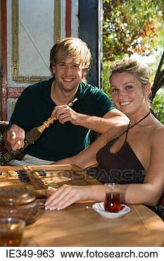 Stock Photo - couple with hookah  and backgammon.  fotosearch - search  stock photos,  pictures, images,  and photo clipart