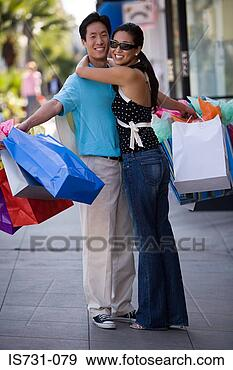 Stock Photograph - couple with shopping bags. fotosearch - search stock photos, pictures, images, and photo clipart