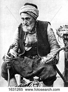 Stock Image - a peasant drinking  coffee and smoking  a huqqah, izmir,  turkey, 1936.  fotosearch - search  stock photos,  pictures, images,  and photo clipart