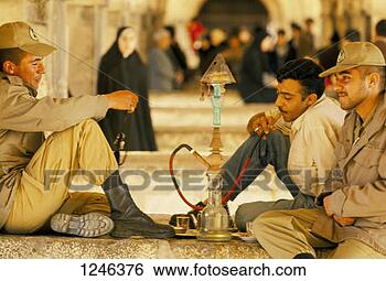 Stock Photo - men smoking a  hookah outside,  iran. fotosearch  - search stock  photos, pictures,  images, and photo  clipart
