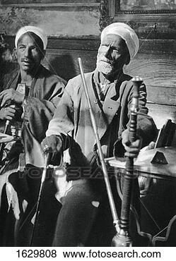 Stock Photo - smoking the narghileh,  cairo, 1937 artist:  martin hurlimann.  fotosearch - search  stock photos,  pictures, images,  and photo clipart