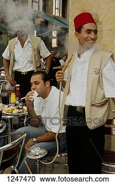 Stock Photography - men smoking and  eating outside  a cafe, beirut,  lebanon. fotosearch  - search stock  photos, pictures,  images, and photo  clipart