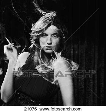 Stock Photo - portrait of woman  smoking, black  and white studio  shot. fotosearch  - search stock  photos, pictures,  wall murals, images,  and photo clipart