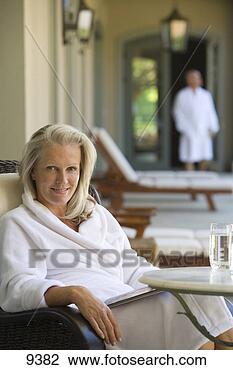 Stock Photo Of Mature Woman Wearing White Bath Robe
