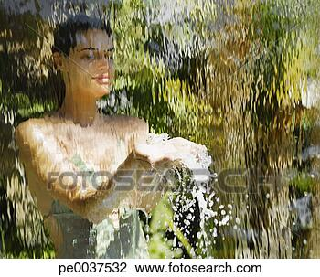 Stock Photo of Woman in a bathing suit behind a waterfall ...
