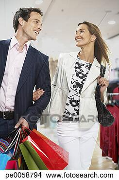 Stock Photo - couple with shopping bags. fotosearch - search stock photos, pictures, images, and photo clipart