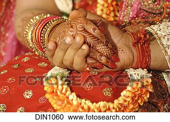 of Bride and Groom taking each others hands in a Indian hindu wedding
