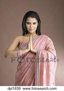 ... doing namste wearing pink colour saree with brown background MR # 702