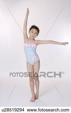 Stock Photo of Girl wearing one piece swimsuit with arm ...