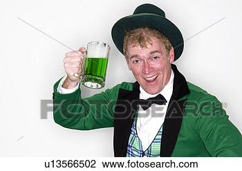 Stock Photo - man dressed as  leprechaun with  mug of green beer.  fotosearch - search  stock photos,  pictures, images,  and photo clipart