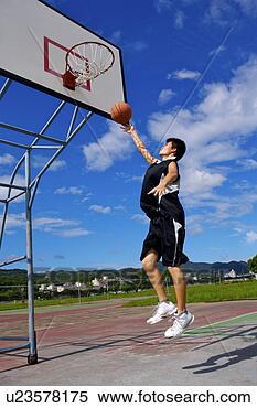 stock image of teenage boy playing basketball u23578175
