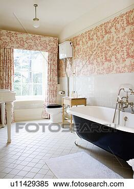 Stock Image - pink toile-de-jouy  curtains and wallpaper  in country bathroom  with. fotosearch  - search stock  photos, pictures,  wall murals, images,  and photo clipart