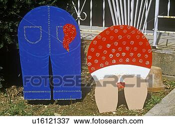 Picture - cutout lawn ornaments  of rear ends of  couple gardening.  fotosearch - search  stock photos,  pictures, wall  murals, images,  and photo clipart