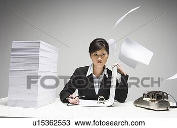 Banco de Imagem - escrita, negócio,  mulher, voando,  papeis. fotosearch  - busca de fotos,  imagens e clipart