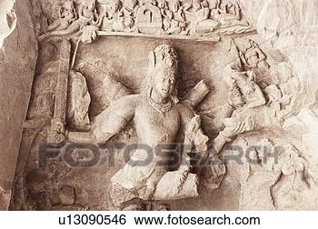 Stock Photo - close-up of a  sculpture curved  on the wall of  a cave,  elephanta.  fotosearch - search  stock photos,  pictures, images,  and photo clipart