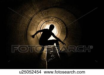 Stock Photo - hiding in a drain 