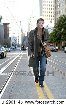 Stock image mature man walking down the street fotosearch search