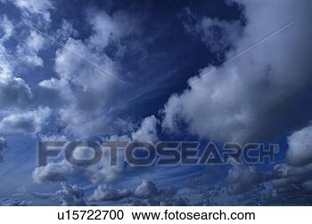 Stock Photography - dark blue stormy  sky. fotosearch  - search stock  photos, pictures,  wall murals, images,  and photo clipart